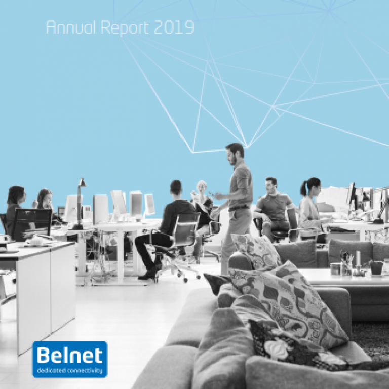 Cover of the 2019 Annual Report. Employees are in an open space, some working, some talking.