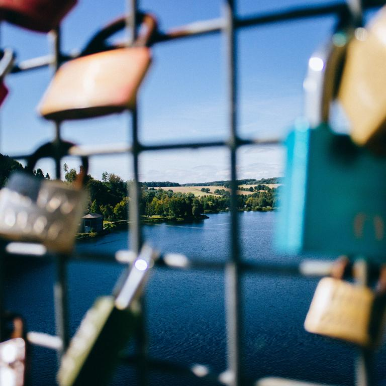 Padlocks attached to a bridge